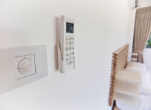 Remote control on the wall a Stock Photography