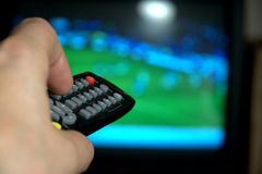Remote control for watching TV. The tv remote control in the hand searches through the canal stock images