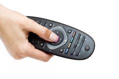 Remote control and woman's hand Royalty Free Stock Photo