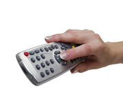 Remote control. Woman's hand with a remote control from the set-top box, isolated on white Royalty Free Stock Photo