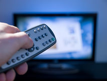 Remote controll and tv Royalty Free Stock Photography