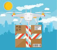 Quadcopter drone with box. Royalty Free Stock Images