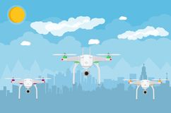 Remote controlled aerial drone in sky Stock Photos