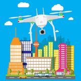 Remote controlled aerial drone in sky. Quadcopter drone with camera for photography or video. Contemporary unmanned aircraft. Cityscape, clouds, sky, road Royalty Free Stock Photos