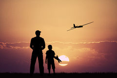 Remote controlled airplanes at sunset Stock Photography