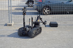 A Remote Controlled Bomb Disposal Robot. A bomb disposal robot being put through its paces opening an abandoned case Stock Photos