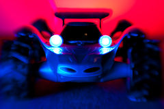 Remote controlled car. With headlight, blur, and red and blue dramatic lighting stock photo