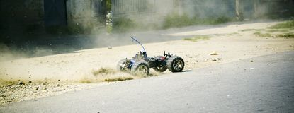 Remote Controlled Car. Accelerating and dust flying out behind Royalty Free Stock Photo