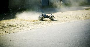 Remote Controlled Car. Accelerating and throwing up cloud of dust stock photo