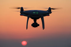 Remote controlled drone flying in air and sunset sky. KAGAWA, JAPAN - JUNE 15, 2017: Remote controlled drone Dji Phantom 4 Pro equipped with high resolution Royalty Free Stock Images