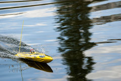 A remote controlled military speedboat. On a pond in full speed Royalty Free Stock Images