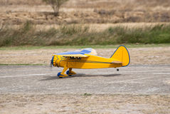 Remote controlled yellow airplane Royalty Free Stock Photography