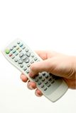 Remote controller. In a men's hand Royalty Free Stock Photography