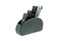 Remote controllers in leather holder stock photography