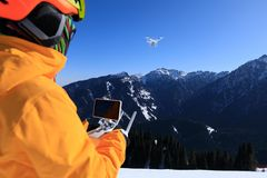 Remote controlling a flying drone Royalty Free Stock Photography