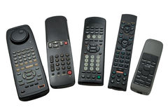 Remote controls. Five remote controls, isolated on white Stock Images