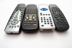 Remote controls. Four remote controls isolated on the white background Royalty Free Stock Photography
