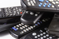 Remote controls. Pile of remote controls royalty free stock images