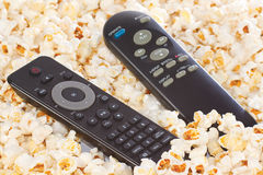 Remote controls in popcorn closeup Royalty Free Stock Photography