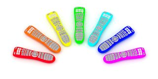 Remote controls of rainbow colors Stock Photos