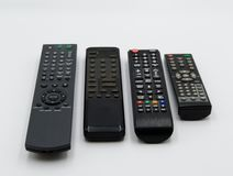 Remote controls on a table royalty free stock photos