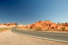 Remote desert highway Stock Images