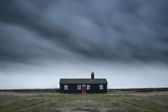 Remote desolate isolated house under dark stormy sky during Wint Royalty Free Stock Photos