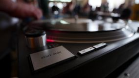 Remote DJ close-up. Turntables, buttons and men`s hand