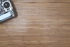 Remote for the drone. On wooden background, quadcopter Stock Images