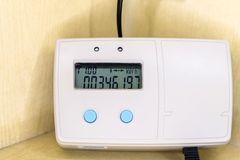 Remote electronic modern smart grid residential digital power supply meter royalty free stock photo