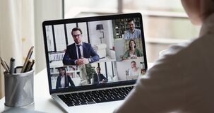 Remote employee conferencing boss and coworkers in online virtual chat