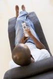 remote för stolskontrollman som sitter genom att använda arkivbilder