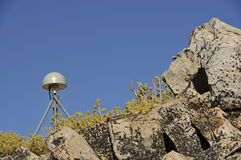 Remote GPS Antenna. Station on Top of Mountain Peak Amoungst Natural Rock Formations Stock Photo