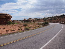 Remote highway curving into the desert Royalty Free Stock Photo