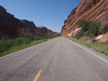 Remote highway cutting through a desert canyon Royalty Free Stock Photos