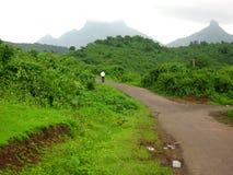 Remote hillside road Stock Images