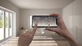 Remote home control system on a digital smart phone tablet. Device with app icons. Interior of minimalist living room in the backg. Round, architecture design stock photo