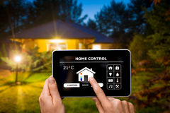 Remote home control system on a digital tablet. Remote home control system on a digital tablet or phone Stock Photo