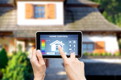 Remote home control system on a digital tablet. Remote home control system on a digital tablet or phone Stock Image