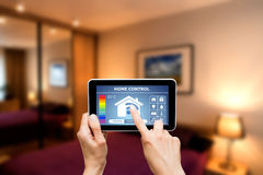 Remote Home Control System On A Digital Tablet. Royalty Free Stock Photography