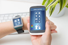 Remote home control system on a smart phone. Stock Photography