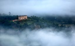 Remote house hidden within the clouds royalty free stock photos