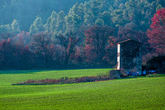 Remote house in Provence, France near a beautiful green field. Shot in a quiet afternoon just about when sun was about to set Stock Photo