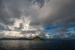Remote Islands and Rain Clouds Royalty Free Stock Photo