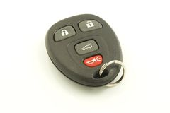 Remote Keyless System. Automobile remote keyless system keyring with buttons for lock, unlock, open trunk and alarm Royalty Free Stock Images