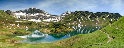 Remote lake up high in the alpine mountains. Schrecksee. Remote Schrecksee lake up high in the alpine mountains in spring or summer. The island in the lake is Stock Image