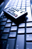 Remote on Laptop Keyboard Stock Image