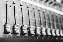 Remote mixer track. The sliders mixing console closeup,with audio and effects, the distribution of the input channels, output volume Royalty Free Stock Image