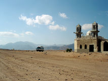Remote Mosque. The construction of a Mosque in a remote part of the Siani Desert attracts tourest busses stock photos