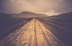 Remote muddy mountain road Stock Photography